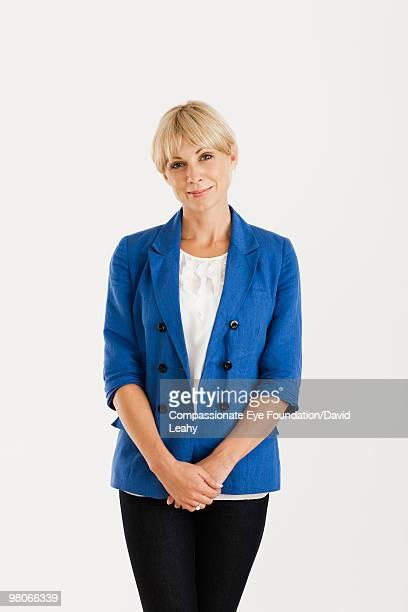 Portrait of blonde woman in a blue blazer
