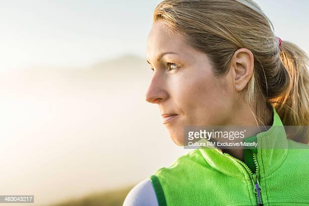 Portrait of blonde woman, looking away