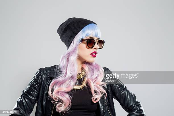 Portrait of blue-pink hair carefree girl wearing leather jacket
