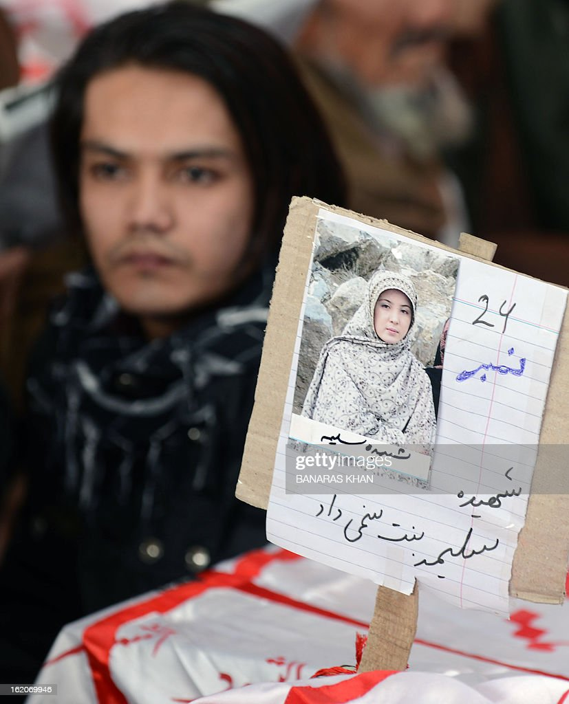 A portrait of bomb victim Sleema is pictured on her coffin on the third day of protests following Saturday's bombing in Quetta on February 19, 2013, against the bombing targeted Shiite Muslims. Pakistani forces on Tuesday killed four men and arrested seven others accused of killing Shiite Muslims, including an alleged mastermind of a bomb attack that killed 89 people, officials said. AFP PHOTO/Banaras KHAN