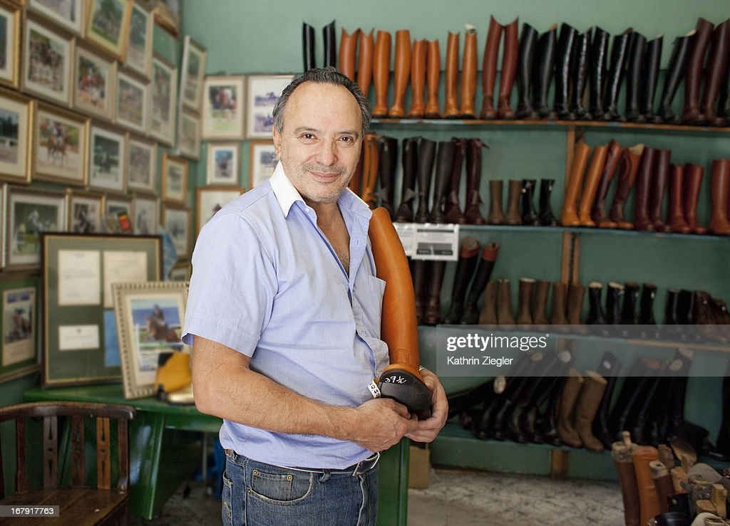 portrait of boot maker in his shop : Stock Photo