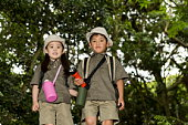 Portrait of boy and girl in forest