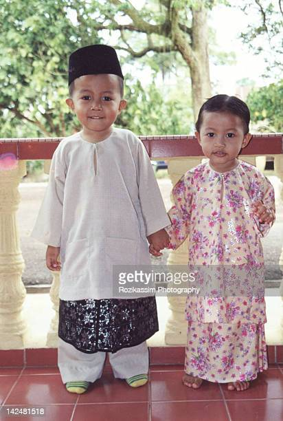 Portrait of boy and girl with traditional custom