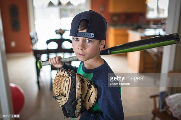 Portrait of boy baseball player with attitude