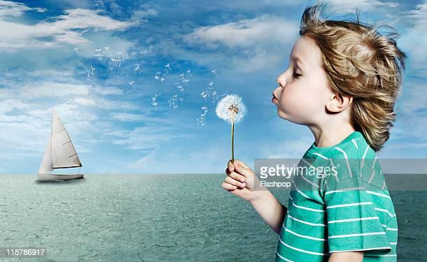 Portrait of boy blowing dandelion clock