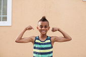 Portrait of boy flexing muscles