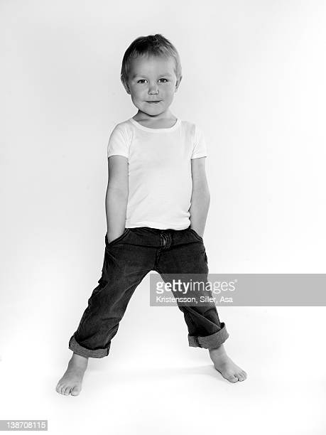 Portrait of boy in astride with hands in pockets
