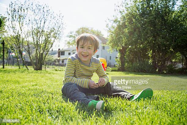Portrait of boy (6-7) in backyard