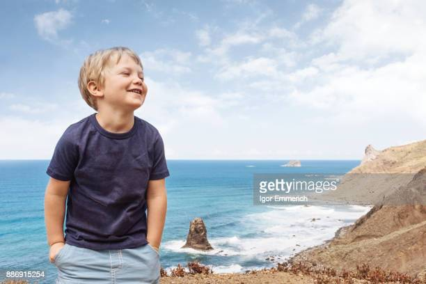 Portrait of boy in coastal setting, Santa Cruz de Tenerife, Canary Islands, Spain, Europe