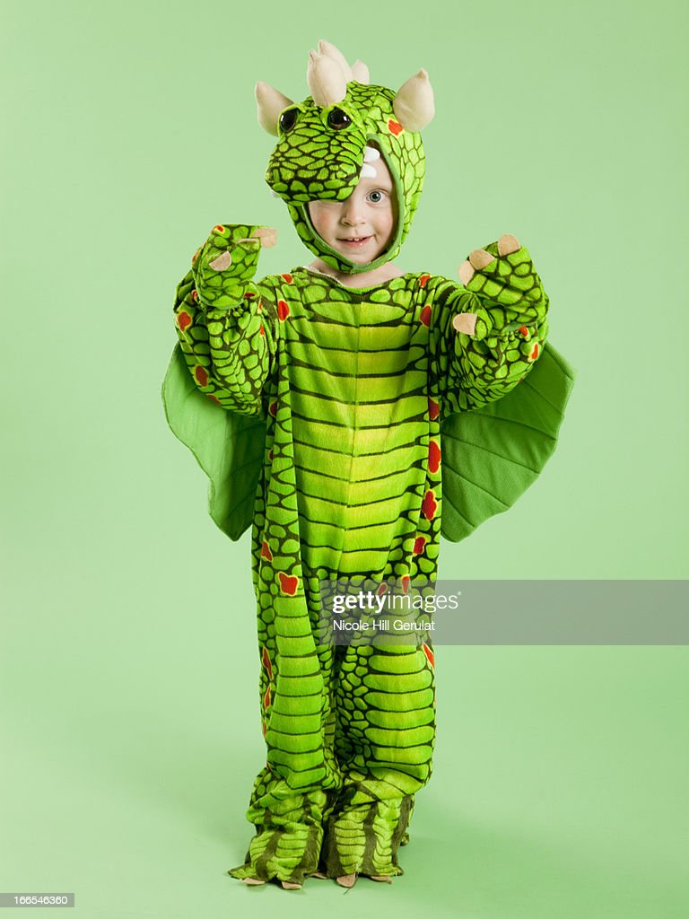 Portrait of boy (2-3) in dragon costume for Halloween