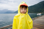 Portrait of boy in ducky raincoat