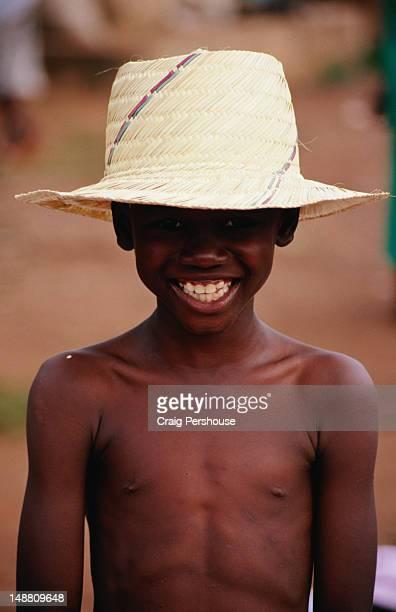 Portrait of boy in straw hat.