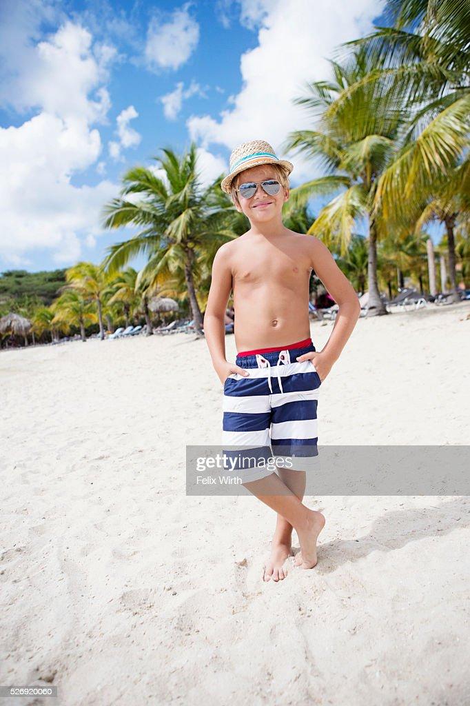 Portrait of boy (4-5) in sunglasses on beach : Bildbanksbilder