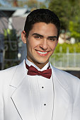 Portrait of boy (13-15) in tuxedo at Quinceanera