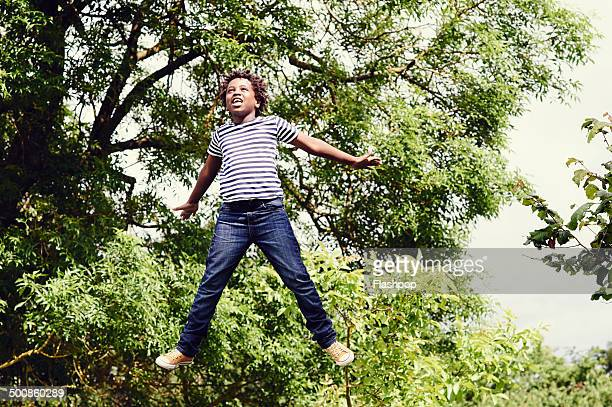 Portrait of boy jumping in the air