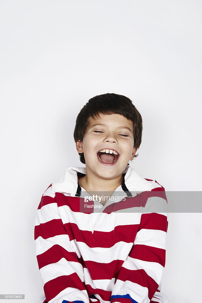 Portrait of boy laughing : Stock Photo