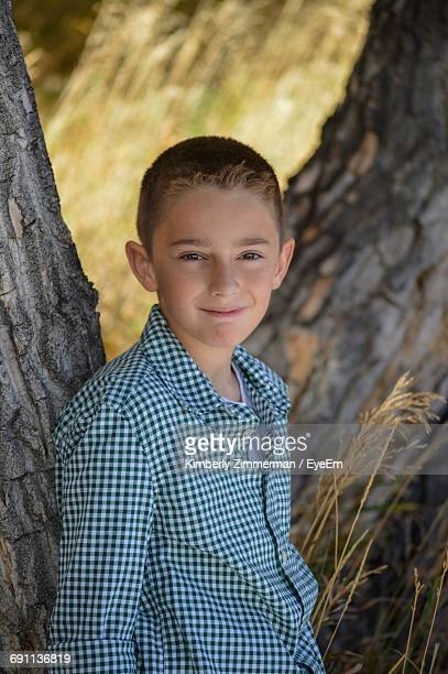Portrait Of Boy Leaning On Tree At Cherry Creek State Park
