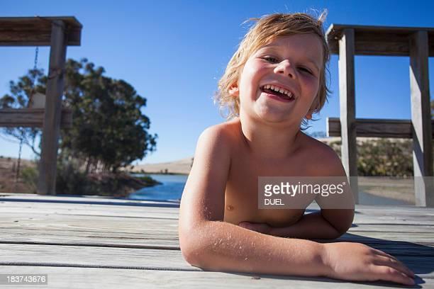 Portrait of boy on pier, smiling