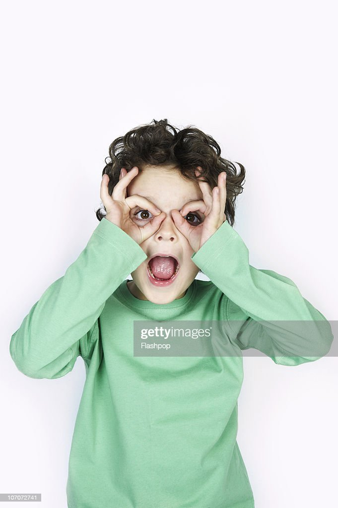Portrait of boy pulling a funny face : Stock Photo