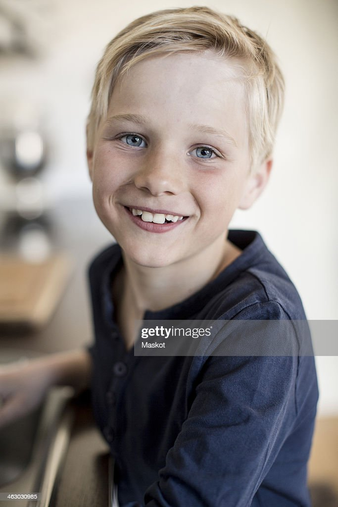 Portrait of boy smiling in kitchen