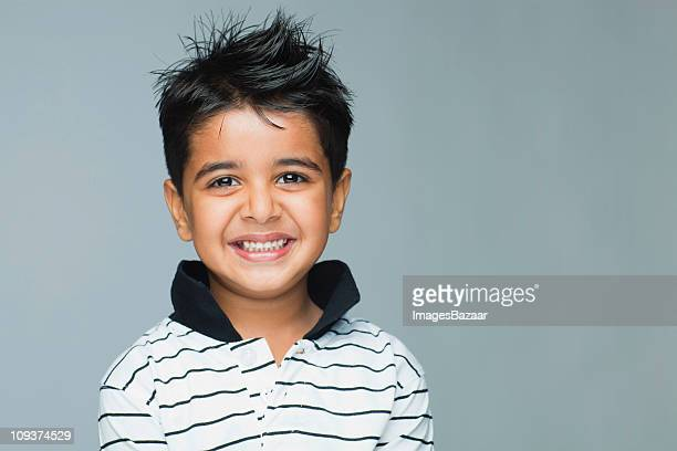 Portrait of boy (6-7) smiling