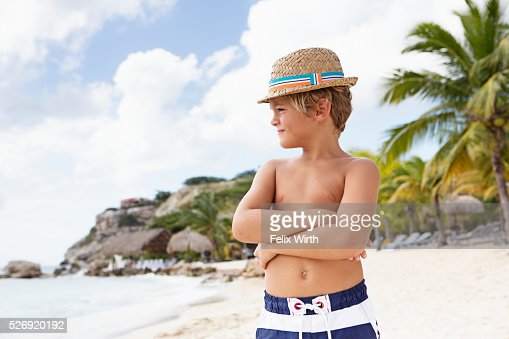 Portrait of boy (4-5) standing on beach : Bildbanksbilder