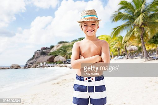 Portrait of boy (4-5) standing on beach : Stock Photo