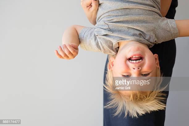 Portrait of boy (2-3) upside down