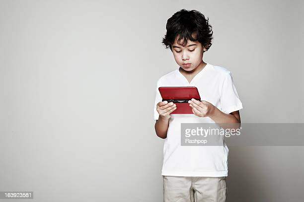 Portrait of boy using computer tablet