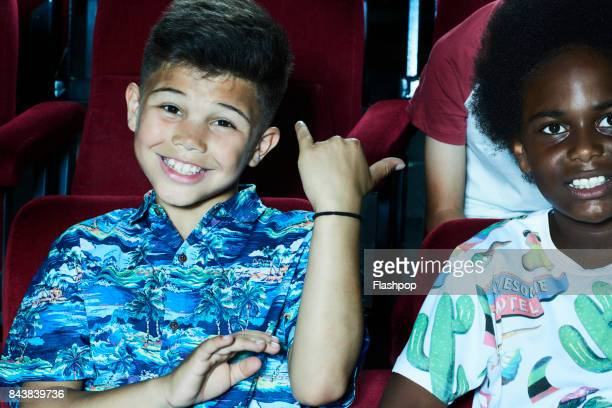 Portrait of boy watching a movie at the cinema