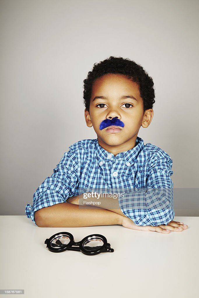 Portrait of boy wearing a moustache : Stock Photo
