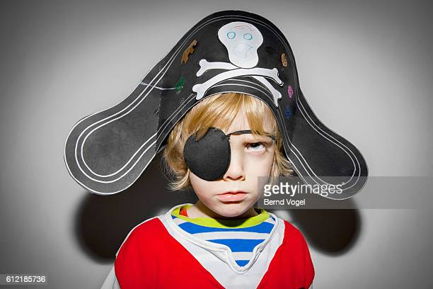Portrait of boy (6-7) wearing pirate costume
