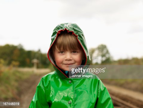 Portrait of boy wearing rain jacket : Stock Photo
