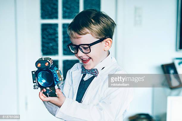Portrait of boy who plays with toy robot