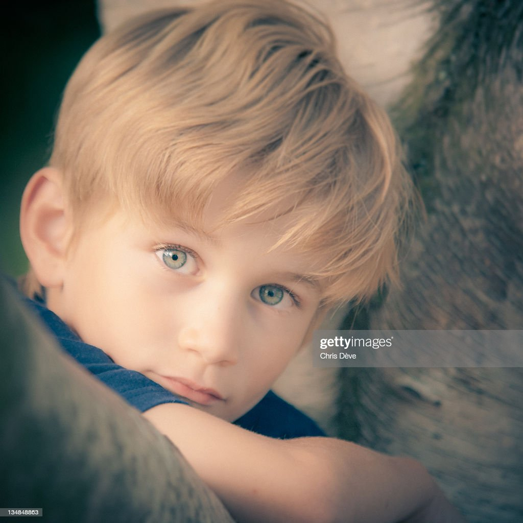 Portrait of boy with blond hair : Stock Photo