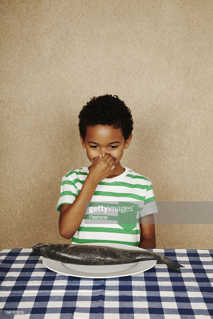 Portrait of boy with fish : Stock Photo