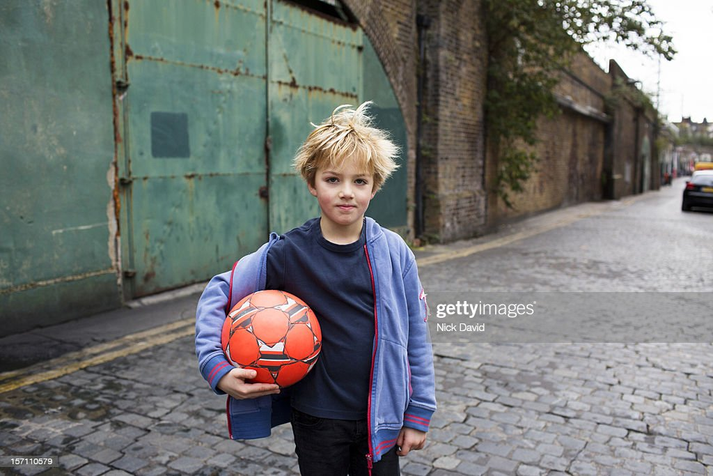 portrait of boy with football : Stock Photo