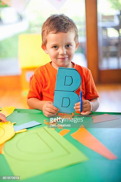 Portrait of boy with letter B at nursery school