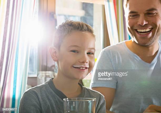 Portrait of boy with milk moustache