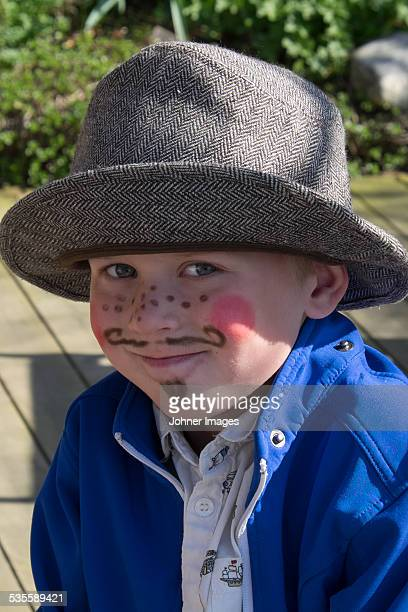 Portrait of boy with painted face