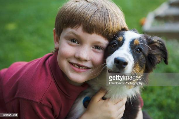 Portrait of boy with pet dog