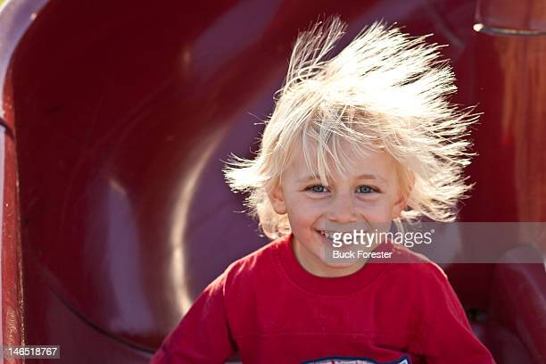 Portrait of boy with static hair