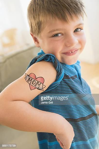 Portrait of boy (6-7) with tattoo on shoulder