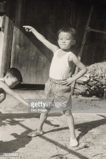 Portrait of boys playing at the backyard : Stock Photo