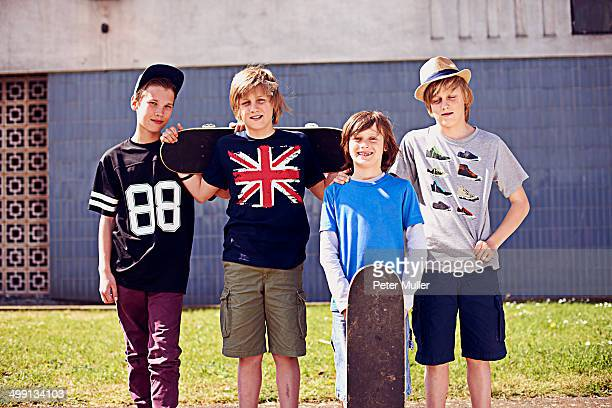 Portrait of boys with skateboards
