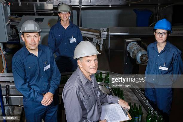 Portrait of brewery workers