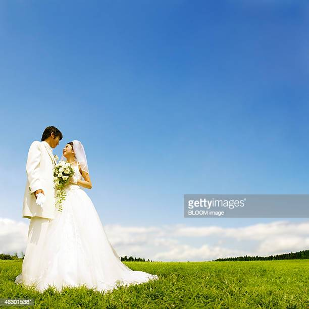 Portrait Of Bride And Groom In Grass