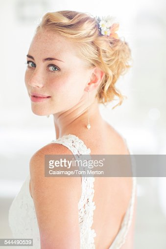 Portrait of bride in domestic room