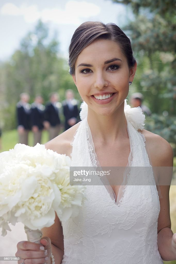 Portrait of bride in white wedding dress