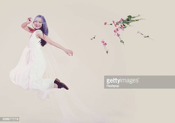 Portrait of bride throwing her flowers